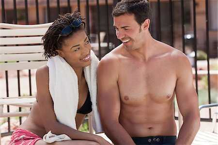 shirtless men - Couple relaxing by swimming pool Stock Photo - Premium Royalty-Free, Code: 614-06719017