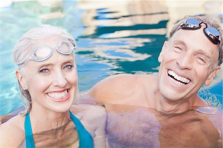 Older couple swimming in pool Stock Photo - Premium Royalty-Free, Code: 614-06719048