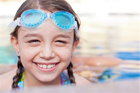 Close up of girl wearing goggles in pool Stock Photo - Premium Royalty-Free, Code: 614-06719041