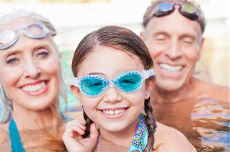 Girl and grandparents swimming in pool Stock Photo - Premium Royalty-Free, Code: 614-06719042