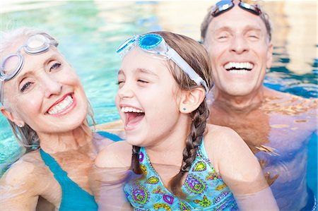Girl and grandparents swimming in pool Stock Photo - Premium Royalty-Free, Code: 614-06719043