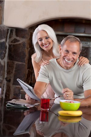 Older couple smiling at breakfast Stock Photo - Premium Royalty-Free, Code: 614-06719056