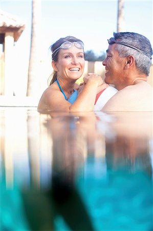 Couple swimming together in pool Stock Photo - Premium Royalty-Free, Code: 614-06719052