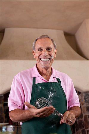 Older man baking in kitchen Stock Photo - Premium Royalty-Free, Code: 614-06719070