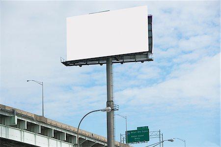 Blank billboard over freeway Stock Photo - Premium Royalty-Free, Code: 614-06719127