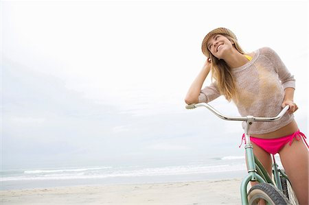 Woman on bicycle on beach Stock Photo - Premium Royalty-Free, Code: 614-06719150