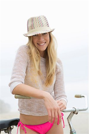 Woman on bicycle on beach Stock Photo - Premium Royalty-Free, Code: 614-06719153