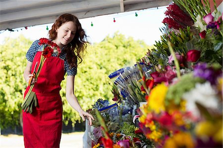 Florist working in shop Stock Photo - Premium Royalty-Free, Code: 614-06719195