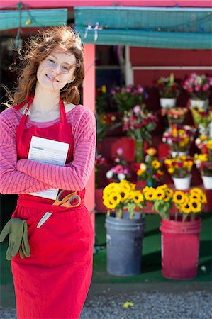 florist - Florist holding notebook in shop Stock Photo - Premium Royalty-Free, Code: 614-06719201