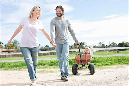 pulling - Parents pulling son in wagon Stock Photo - Premium Royalty-Free, Code: 614-06719254