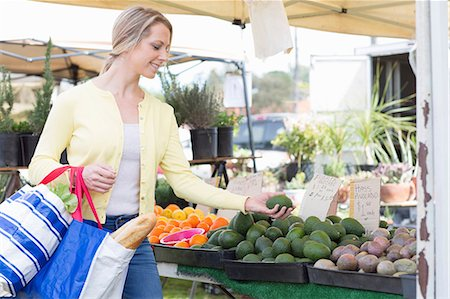 Woman shopping at farmer's market Stock Photo - Premium Royalty-Free, Code: 614-06719289
