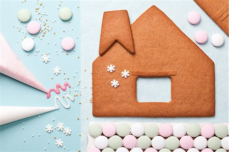 snowflakes  holiday - Gingerbread house components on table Stock Photo - Premium Royalty-Free, Code: 614-06719347