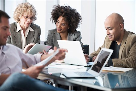 Business people talking in meeting Stock Photo - Premium Royalty-Free, Code: 614-06719382