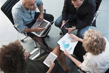 Business people talking in office Stock Photo - Premium Royalty-Free, Code: 614-06719450