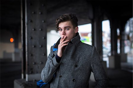 smoke - Man smoking cigarette outdoors Stock Photo - Premium Royalty-Free, Code: 614-06719566