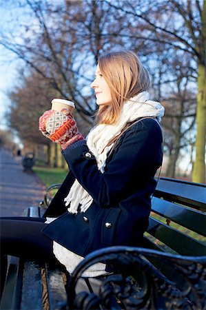 Woman having coffee on park bench Stock Photo - Premium Royalty-Free, Code: 614-06719605