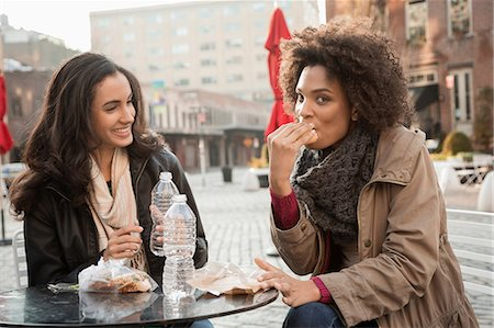 Women eating together at sidewalk cafe Stock Photo - Premium Royalty-Free, Code: 614-06719689