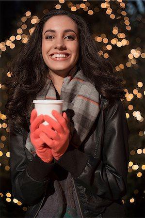 Woman having coffee on city street Stock Photo - Premium Royalty-Free, Code: 614-06719717