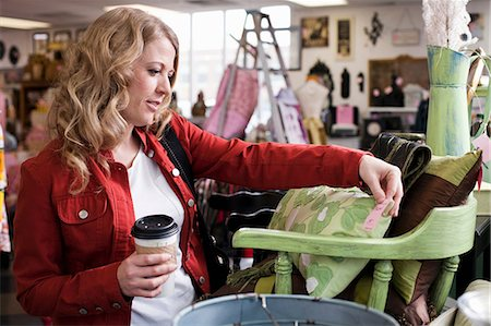 Woman shopping in thrift store Stock Photo - Premium Royalty-Free, Code: 614-06719948