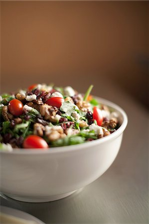 Bowl of chopped salad on table Stock Photo - Premium Royalty-Free, Code: 614-06719941