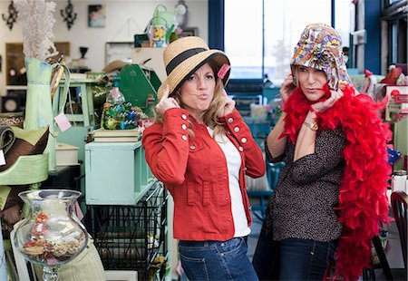 funny pose - Women shopping in thrift store Stock Photo - Premium Royalty-Free, Code: 614-06719962