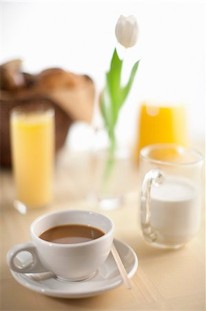 Cup of coffee with milk and orange juice Stock Photo - Premium Royalty-Free, Code: 614-06720026