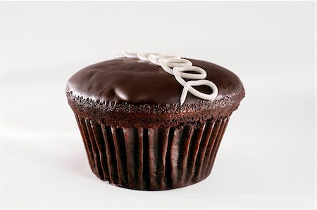 sweet - Close up of chocolate cupcake Stock Photo - Premium Royalty-Free, Code: 614-06720045