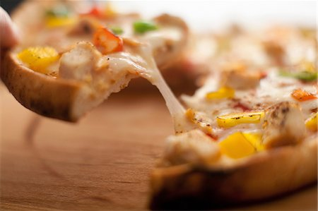 pulling - Close up of pizza crust Stock Photo - Premium Royalty-Free, Code: 614-06720040