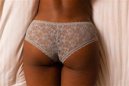 Close up of woman wearing panties Stock Photo - Premium Royalty-Free, Code: 614-06720117
