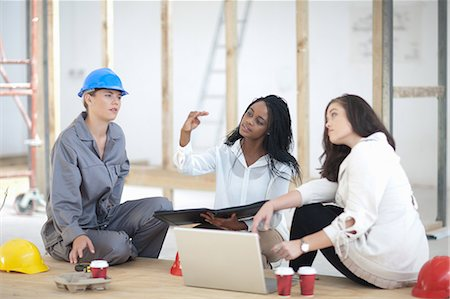decision - Designers and laborer taking break on construction site Stock Photo - Premium Royalty-Free, Code: 614-06814006