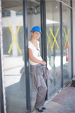 sold sign - Portrait of female construction worker on construction site Stock Photo - Premium Royalty-Free, Code: 614-06814039