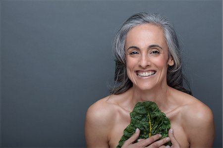 Mature woman with chard Stock Photo - Premium Royalty-Free, Code: 614-06814176