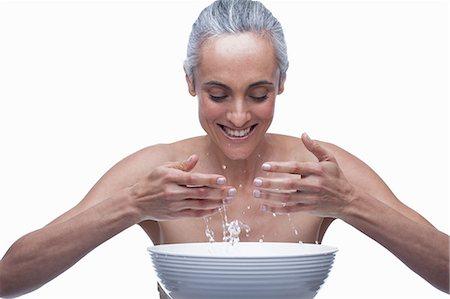 Mature woman washing face Stock Photo - Premium Royalty-Free, Code: 614-06814181