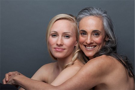 Young woman and mature woman hugging Stock Photo - Premium Royalty-Free, Code: 614-06814213