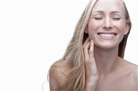 Young woman touching neck Stock Photo - Premium Royalty-Free, Code: 614-06814235