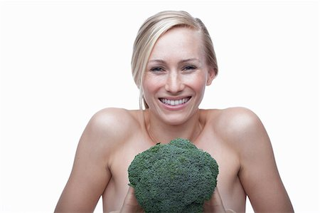 portrait smile caucasian one - Young woman with broccoli Stock Photo - Premium Royalty-Free, Code: 614-06814251