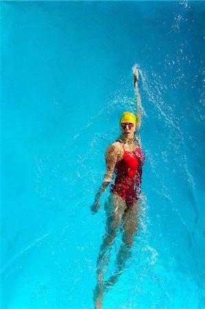 Mature woman doing backstroke in swimming pool Stock Photo - Premium Royalty-Free, Code: 614-06814260