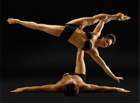 Mid adult couple performing modern dance Stock Photo - Premium Royalty-Free, Code: 614-06814285