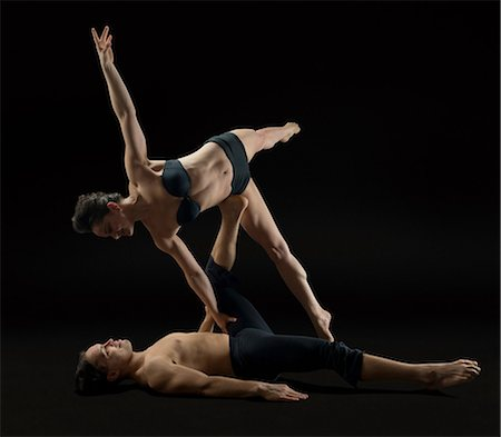 Mid adult couple performing modern dance Stock Photo - Premium Royalty-Free, Code: 614-06814281