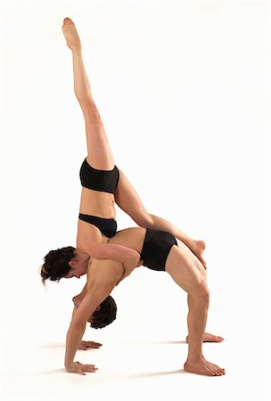 Mid adult couple performing modern dance Stock Photo - Premium Royalty-Free, Code: 614-06814298