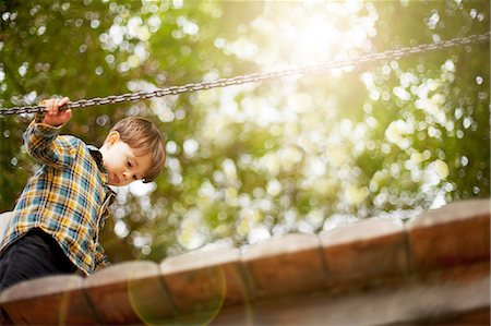 forest - Male toddler crossing wooden footbridge Stock Photo - Premium Royalty-Free, Code: 614-06814358