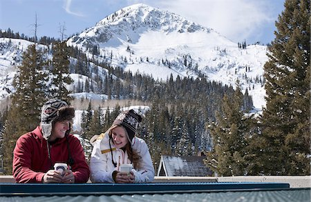 property release - Young couple with hot drinks in Brighton ski resort, Utah, USA Stock Photo - Premium Royalty-Free, Code: 614-06814380