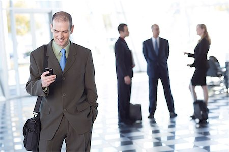 Businessman using cell phone Stock Photo - Premium Royalty-Free, Code: 614-06813211