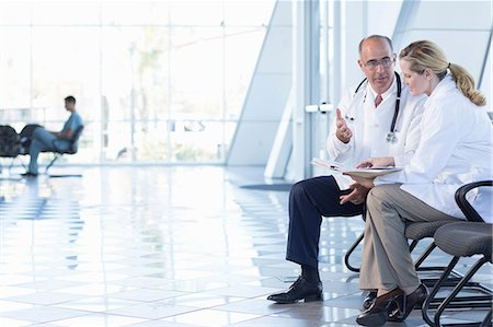 people hospital - Male and female doctors sitting on chairs Stock Photo - Premium Royalty-Free, Code: 614-06813241