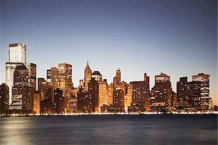 Manhattan skyline at dusk, New York City, USA Stock Photo - Premium Royalty-Free, Code: 614-06813347