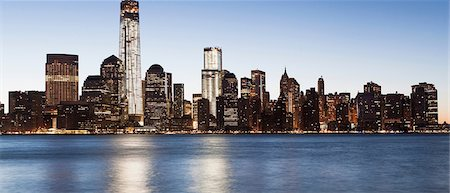 Panoramic Manhattan skyline at dusk, New York City, USA Stock Photo - Premium Royalty-Free, Code: 614-06813349