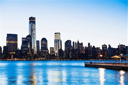 Pier and Manhattan skyline at dusk, New York City, USA Stock Photo - Premium Royalty-Free, Code: 614-06813352
