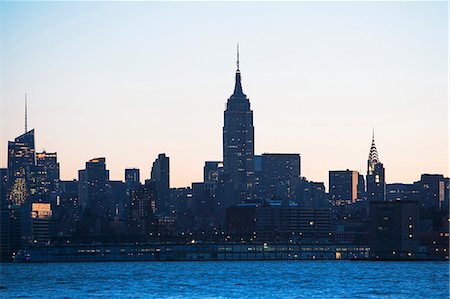 Manhattan skyline at dusk, New York City, USA Stock Photo - Premium Royalty-Free, Code: 614-06813353
