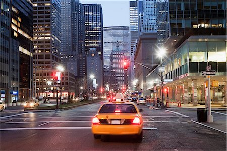 Yellow taxi cab at dusk, New York City, USA Stock Photo - Premium Royalty-Free, Code: 614-06813393