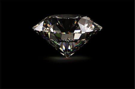 Diamond against black background Stock Photo - Premium Royalty-Free, Code: 614-06813409